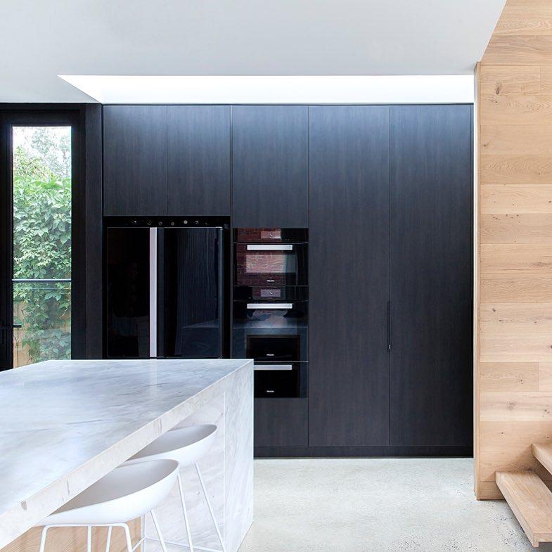 Sexy black appliances amp functional fully retractable pocket doors concealinghellip